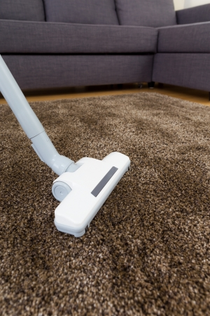 Vacuum cleaner on carpet photo