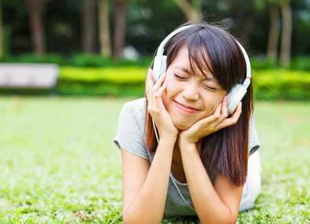 Asian young girl enjoy listen to music photo