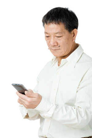Senior man looking at mobile  photo