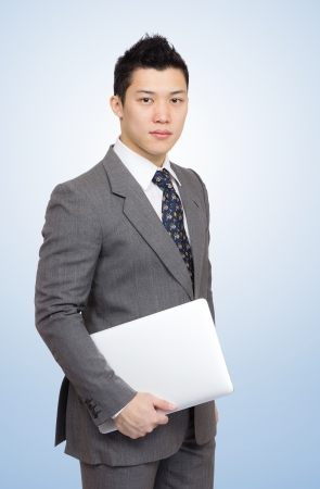 fale: Businessman with notebook for presentation Stock Photo