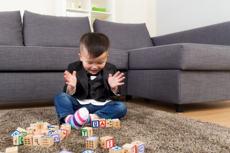 Little boy playing toy block photo