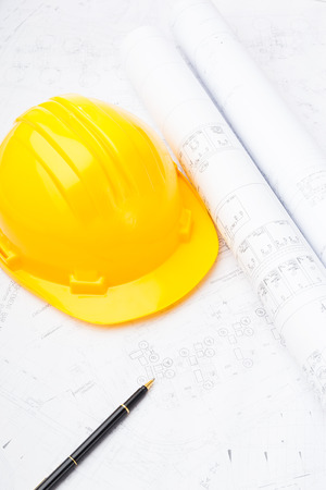 Construction drawing and safety helmet photo