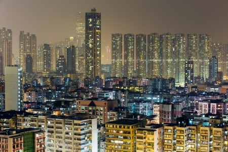 Residential building in Hong Kong at night photo