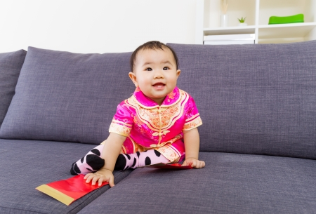 Chinese baby touching red pocket  photo