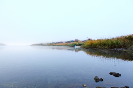 Lake in autumn in misty morning  photo