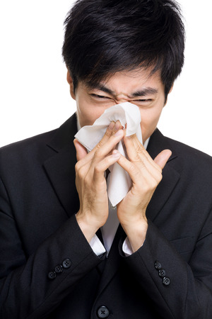 Asian businessman sneezes photo
