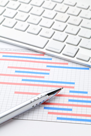 Project plan gantt charts with computer keyboard photo