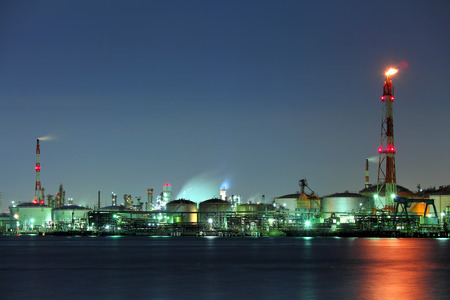 Industrial building and sea at night