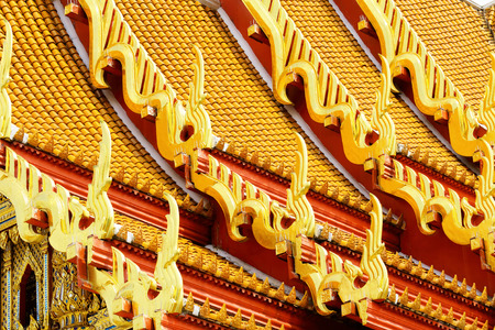 Traditional temple roof tilt in Thailand photo