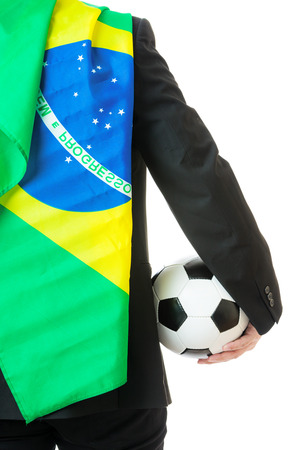 Back view of businessman hold soccer ball with brazil flag photo