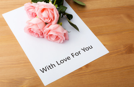 Pink rose and love message photo