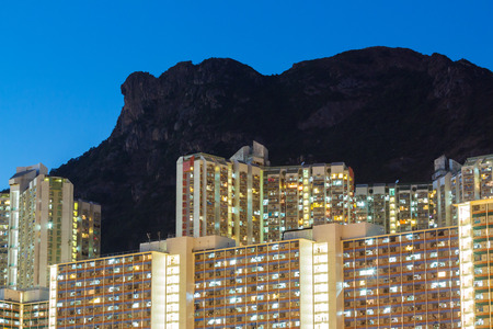 Public housing with lion rock mountain photo