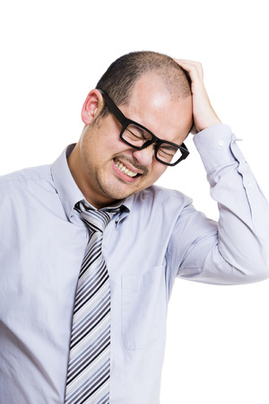 confused man: Businessman scratching his head