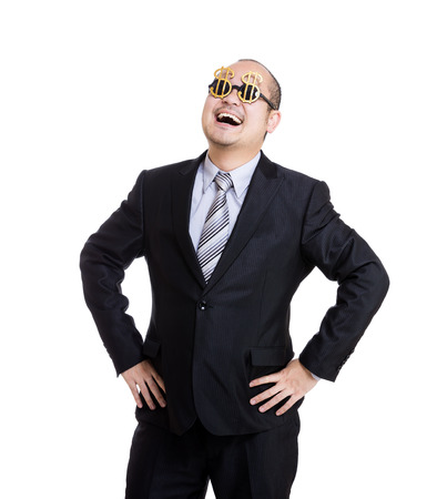 Happy rich businessman wear dollar sign glasses photo