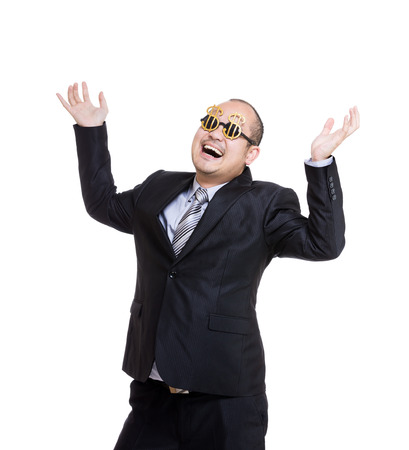 Rich businessman wear dollar sign glasses and hand up photo