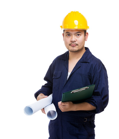 Construction worker holding blue print and file pad photo