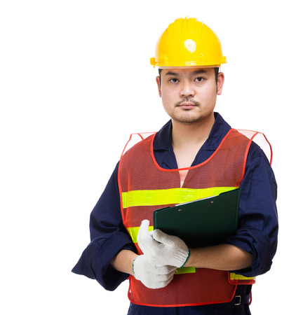 Construction worker holding file pad photo