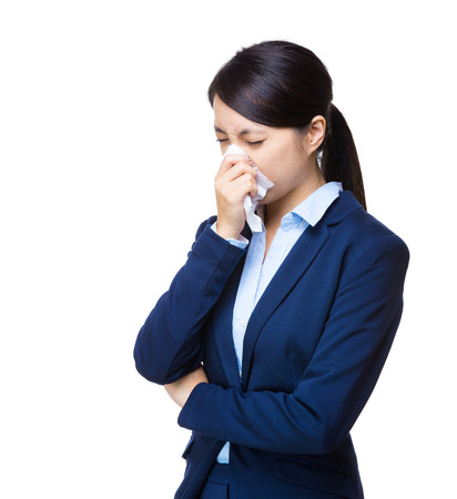 Business woman sneeze photo