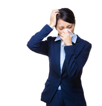 Businesswoman sneeze and headache photo