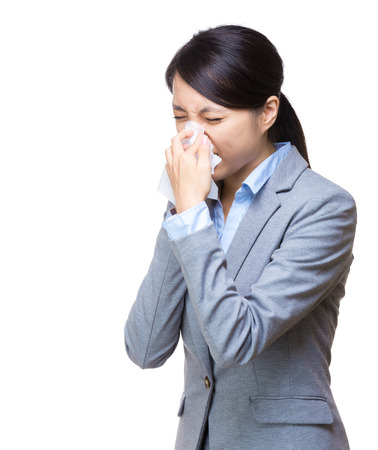 Business woman sneeze isolated on white photo