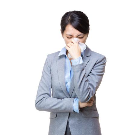 Asian businesswoman sneeze photo