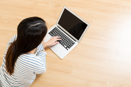 Woman using laptop from top photo