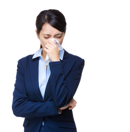 Businesswoman sneeze photo