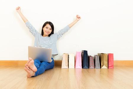 Asian woman shopping at home photo