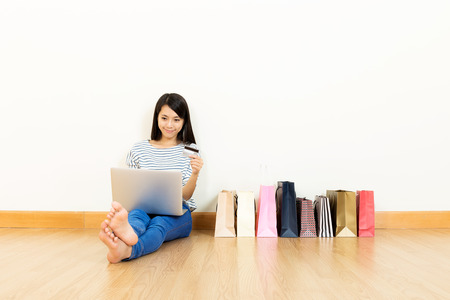 Asian woman shopping online photo