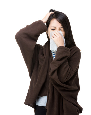 Asia woman sneeze and headache photo