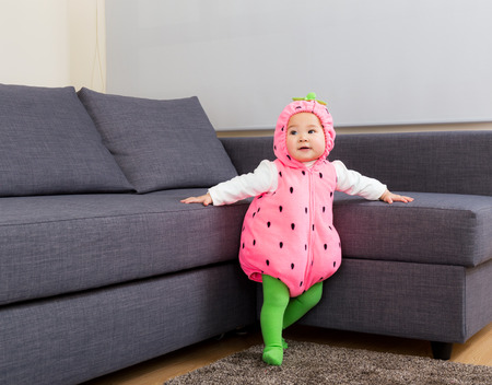 Baby girl dressed in halloween party costume photo