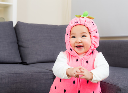 Baby with strawberry costume photo