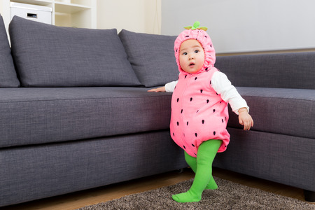 Asia baby with strawberry costume in halloween party photo