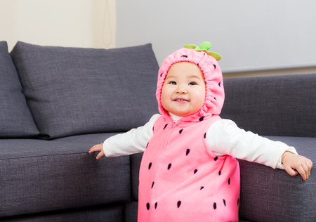 Baby girl dressed in strawberry costume  photo