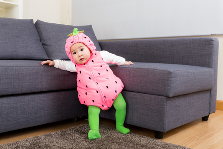 Baby girl with strawberry costume photo