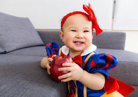 Cute baby girl with apple photo