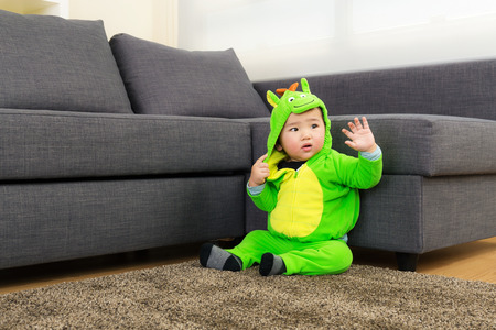 Baby with dinosaur halloween party costume photo