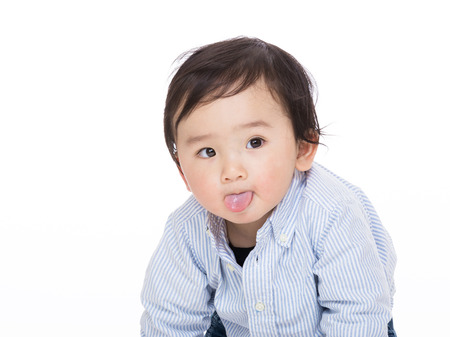 Asian baby making funny face photo