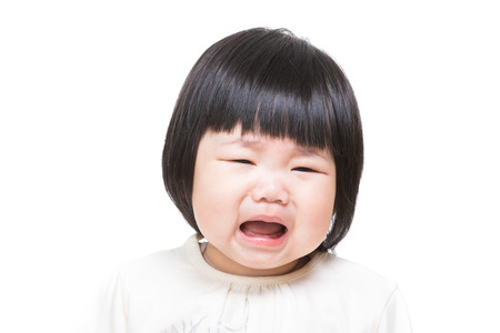 Asian baby girl feeling unhappy photo