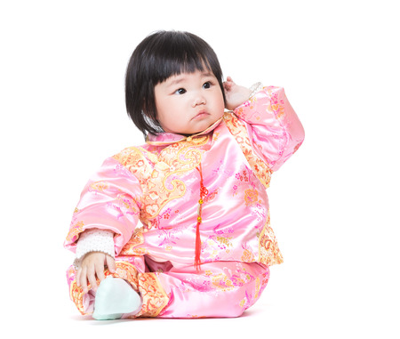 Chinese baby girl scratching hair photo