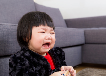 Asian baby crying photo