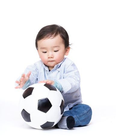 Asian baby boy play with football photo
