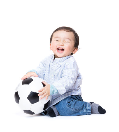 Asiab baby boy feel excited playing soccer ball photo