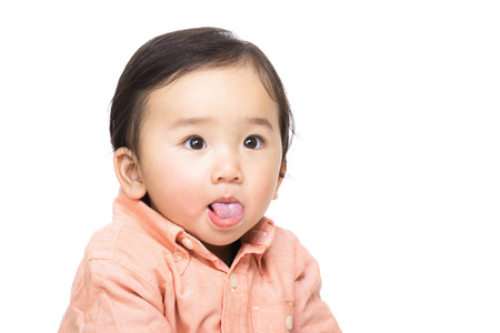 Asia baby making funny face photo