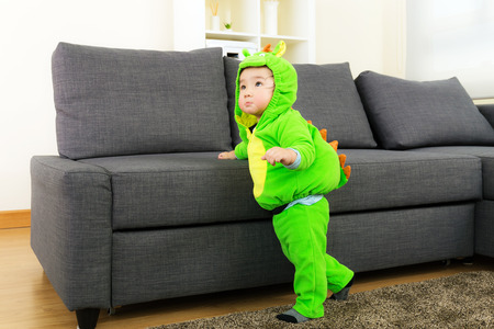 Baby boy with dinosaur halloween party costume photo