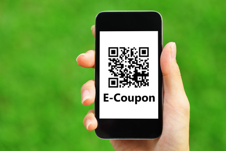 technology background: Coupon QR code on smart phone  Stock Photo