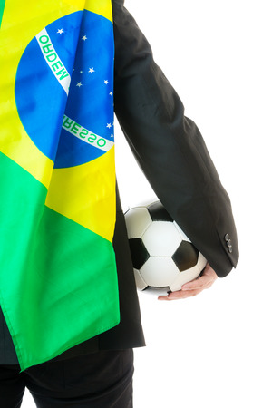 Rear view of businessman with soccer ball and Brazil flag photo