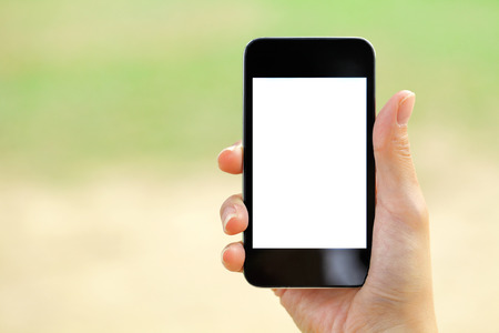 Blank screen mobile phone with woman hand Stock Photo