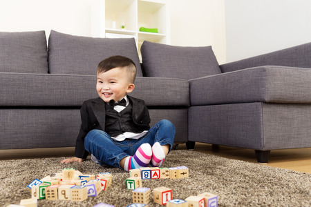 Asia baby boy play toy block photo