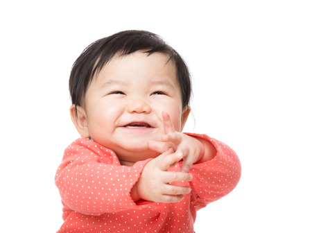 Baby girl feeling excited Stock Photo